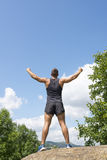 Athletic winner man making victore gesture, outdoor. Royalty Free Stock Photos