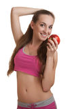 Athletic woman with apple. Athletic woman with an apple, isolated on white Stock Photo