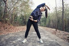 Athletic woman asia warming up and Young female athlete exercisi stock images