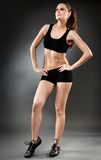 Athletic woman in black sportswear Stock Photo