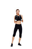 Athletic woman boxing, isolated on white Stock Photography