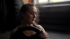 Athletic woman close-up trains abs, doing twisting in slow motion in the gym stock footage