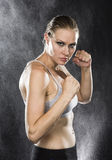 Athletic Woman in Combat Pose with Fierce Look Royalty Free Stock Photos