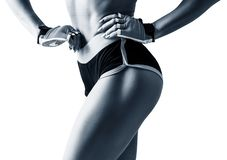 Athletic woman demonstrated her perfect muscular buttocks. royalty free stock image