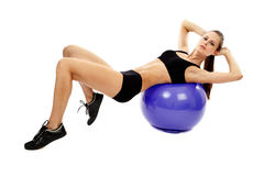 Athletic woman doing abs Royalty Free Stock Photography