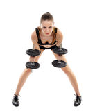 Athletic woman doing dumbbells Royalty Free Stock Images