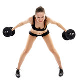 Athletic woman doing dumbbells Stock Images
