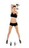 Athletic woman doing dumbbells Royalty Free Stock Photography