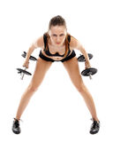 Athletic woman doing dumbbells Royalty Free Stock Photos
