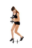 Athletic woman doing dumbbells Stock Image