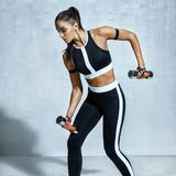Athletic woman doing exercise for arms. Royalty Free Stock Photos