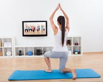 Athletic woman doing exercises at home Royalty Free Stock Photography