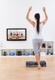 Athletic woman doing home exercises Royalty Free Stock Photography
