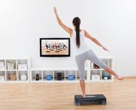 Athletic woman doing home exercises Stock Image