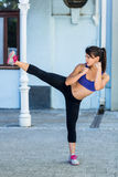 Athletic woman doing martial arts Royalty Free Stock Photography