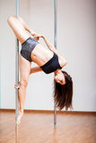 Athletic woman doing pole fitness stock photography