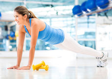 Athletic woman doing push-ups Stock Image