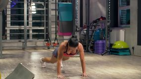 Athletic woman doing push ups. With jumping. Fitness, sports, bodybuilding concept. Slow motion stock video