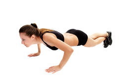 Athletic woman doing pushups Stock Photos