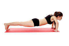 Athletic woman doing pushups Stock Photography