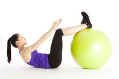 Woman doing sit-ups Stock Images