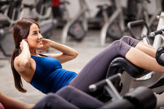 Athletic woman doing some crunches Stock Image