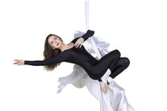 Athletic woman doing some tricks on silks Stock Photos
