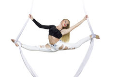 Athletic woman doing some tricks on silks Stock Images