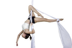 Athletic woman doing some tricks on silks Royalty Free Stock Photography