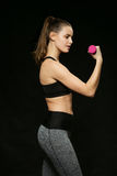 Athletic woman doing sport, lifting weights Stock Images