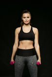 Athletic woman doing sport, lifting weights Royalty Free Stock Photos