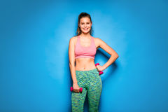 Athletic woman doing sport, lifting weights Stock Photo