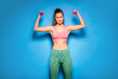 Athletic woman doing sport, lifting weights Stock Photography