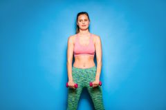 Athletic woman doing sport, lifting weights Royalty Free Stock Images