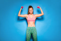 Athletic woman doing sport, lifting weights Stock Photos