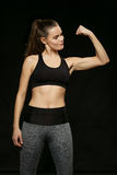 Athletic woman doing sport, lifting weights Royalty Free Stock Photo