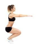 Athletic woman doing squats Stock Photos