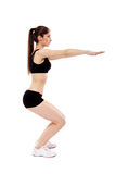 Athletic woman doing squats Royalty Free Stock Photo