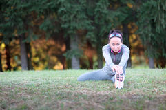 Athletic woman doing stretching exercises outdoors Stock Photography