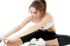 Athletic woman doing stretching exercises. Royalty Free Stock Photos