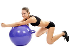 Athletic woman doing stretching Royalty Free Stock Images