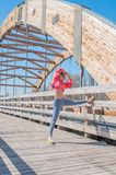 Athletic woman doing warming up and  stretching her legs before running Royalty Free Stock Photography