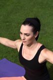 Athletic Woman Doing Yoga Outdoors Stock Photography