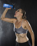 Athletic Woman Drinking Sports Beverage in Bottle Royalty Free Stock Photos