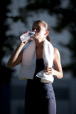 Athletic woman drinking water Stock Photography