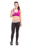 Athletic woman drinking water Stock Photo
