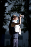 Athletic woman drinking water after jogging. Athletic woman drinking water after evening night Stock Photo
