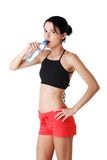 Athletic woman drinking water in sportswear Stock Photography
