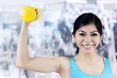Athletic woman with dumbbell Stock Image