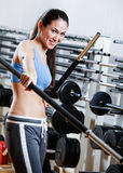 Athletic woman with dumbbells stick Stock Image